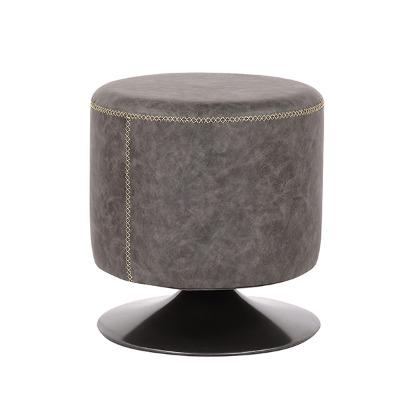 Puff tapizado en eco cuero con base metálica negra  R.572